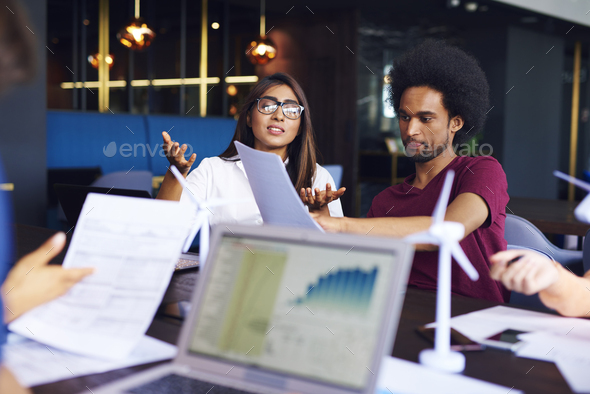 Young business couple doing analysis - Stock Photo - Images