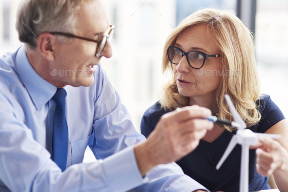 Business partners standing face to face - Stock Photo - Images