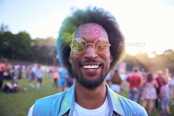 Smiling African man in holi colors - Stock Photo - Images