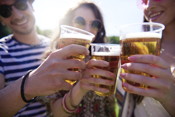 Friends making a cheers outdoors - Stock Photo - Images