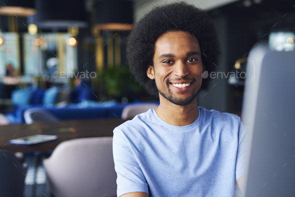 Portrait of African man in the office - Stock Photo - Images