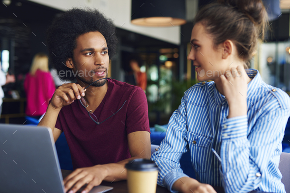Young couple discussing at work - Stock Photo - Images