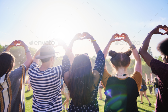 Rear view of friends making a heart with hands - Stock Photo - Images