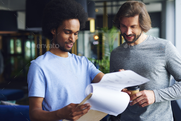 Young coworkers analyzing important documents - Stock Photo - Images