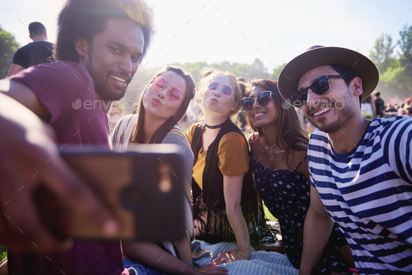 Friends making selfie at the summer festival - Stock Photo - Images