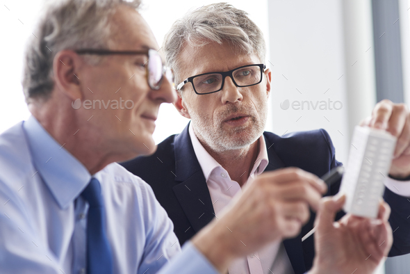 Two mature businessman discussing business plans - Stock Photo - Images