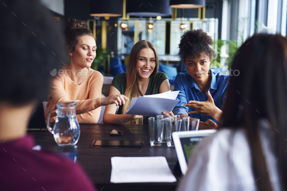 Businesswomen having conference in office - Stock Photo - Images