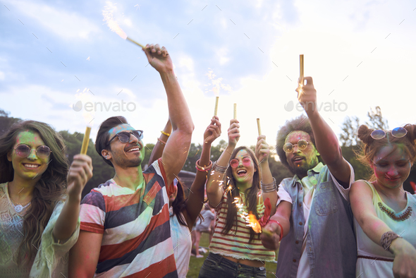 Young people cheering and chilling outside - Stock Photo - Images