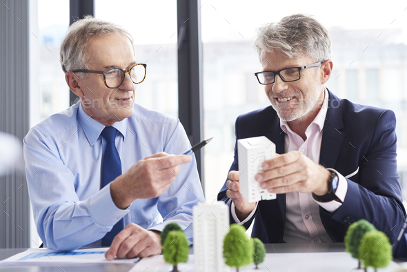 Business partners having a conversation in the office - Stock Photo - Images
