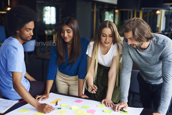 Brainstorming of young business colleagues - Stock Photo - Images