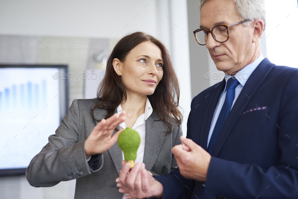 Mature business partners making a conversation - Stock Photo - Images