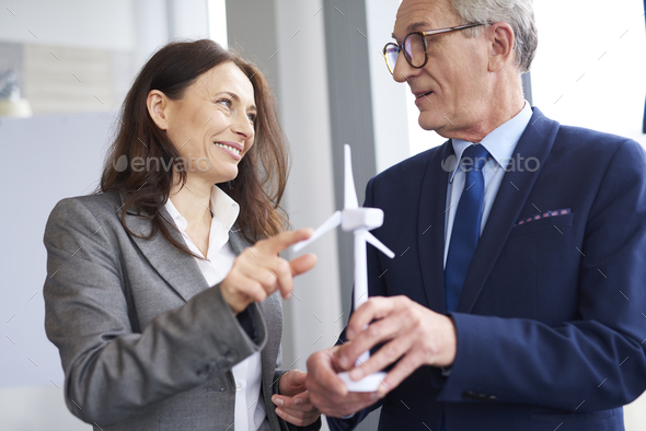 Business workers having a conversation about wind energy - Stock Photo - Images