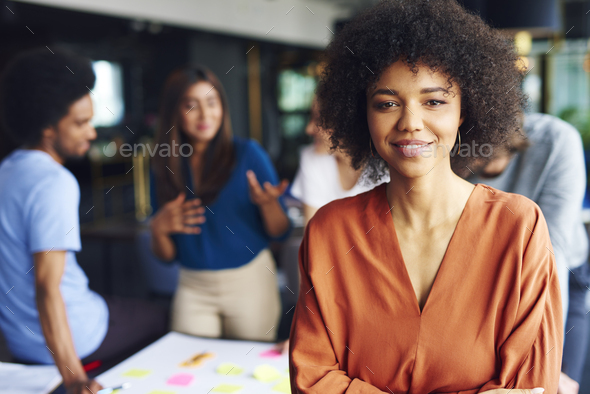 Portrait of African businesswoman leading on this business meeting - Stock Photo - Images