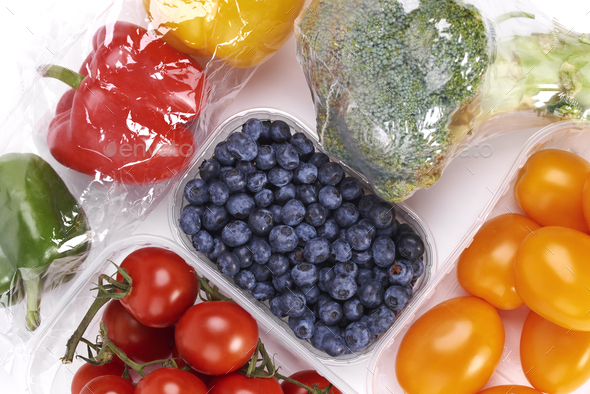 Vegetables and fruits in plastic containers - Stock Photo - Images