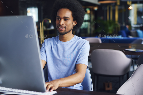 African man working on computer in the office - Stock Photo - Images