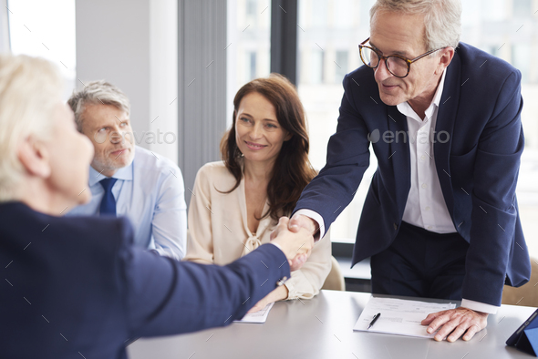 Good deal between business partners during business meeting - Stock Photo - Images