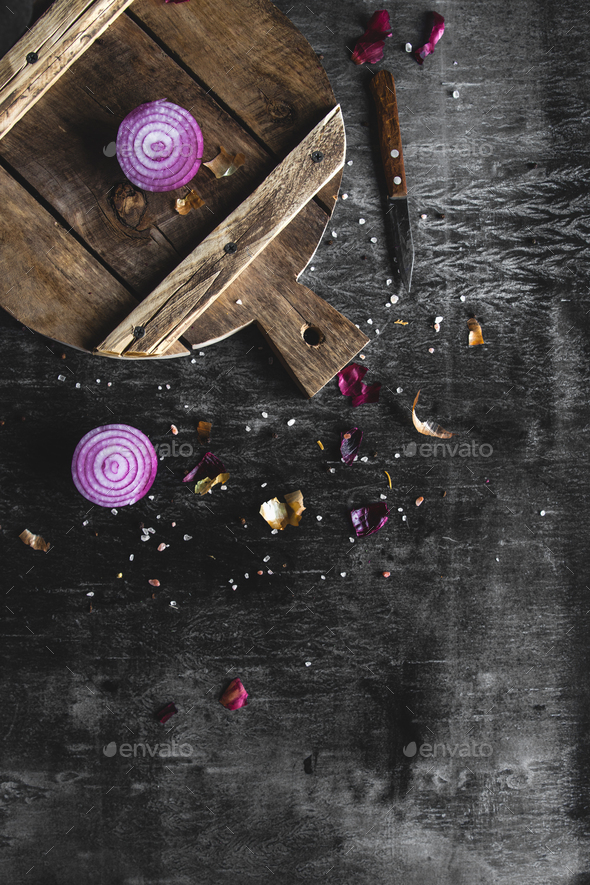 Red Onion Slices on wooden board with dark background - Stock Photo - Images