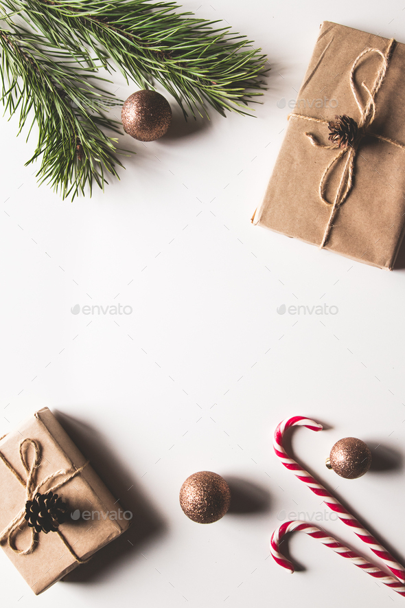 Gift box with christmas green framework and pine cones on white background. Copy space and Top view - Stock Photo - Images