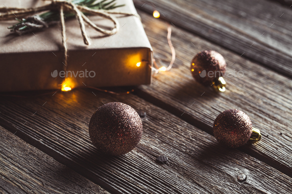 Christmas and New Year background with branch, decorations and presents wrapped in craft papers - Stock Photo - Images