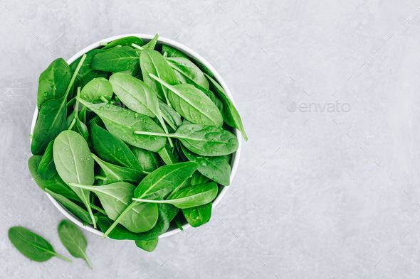 Fresh Spinach Leaves. Raw Spinach in a bowl for vegetarian or vegan salad or smoothie. - Stock Photo - Images