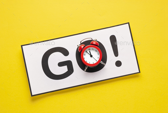 Go sign with alarm clock as O and copy space - Stock Photo - Images