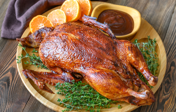 Baked duck on wooden tray - Stock Photo - Images