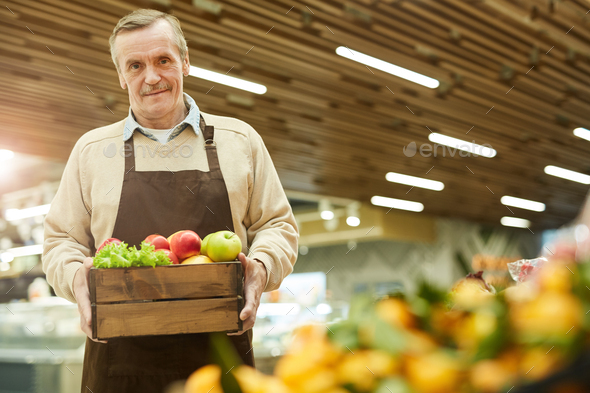 Senior Man Holding Box of Delicious Apples - Stock Photo - Images