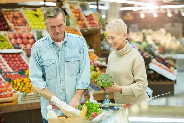 Senior Couple Buying Groceries in Supermarket - Stock Photo - Images