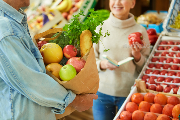 Senior Couple Grocery Shopping at Market - Stock Photo - Images