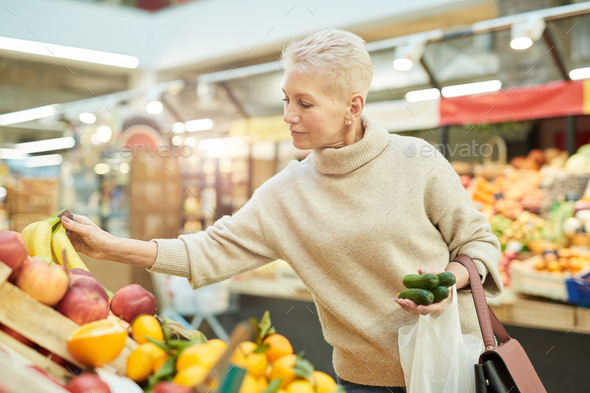 Mature Woman Grocery Shopping at Farmers Market - Stock Photo - Images