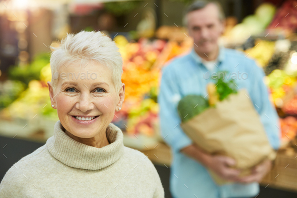 Smiling Senior Woman in Supermarket - Stock Photo - Images