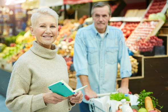 Smiling Senior Woman Buying Groceries in Supermarket - Stock Photo - Images