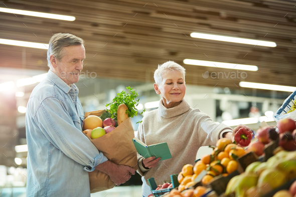 Senior Couple Grocery Shopping at Farmers Market - Stock Photo - Images