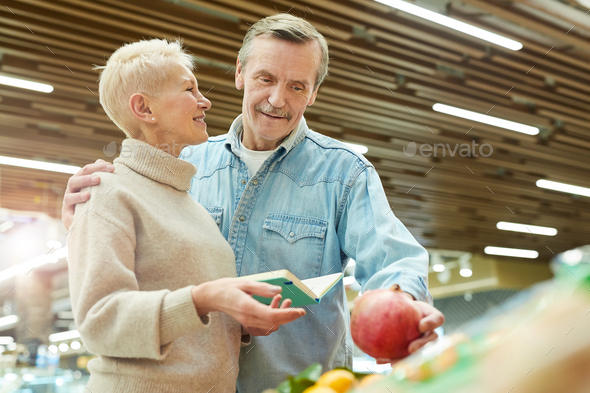 Smiling Senior Couple Grocery Shopping at Farmers Market - Stock Photo - Images