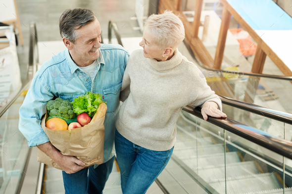 Modern Senior Couple Shopping in Mall - Stock Photo - Images