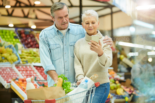 Modern Senior Couple Shopping in Supermarket - Stock Photo - Images