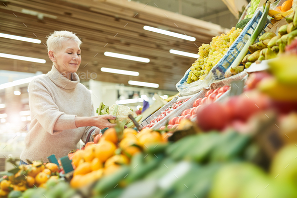 Woman Choosing Fresh Vegetables at Market - Stock Photo - Images