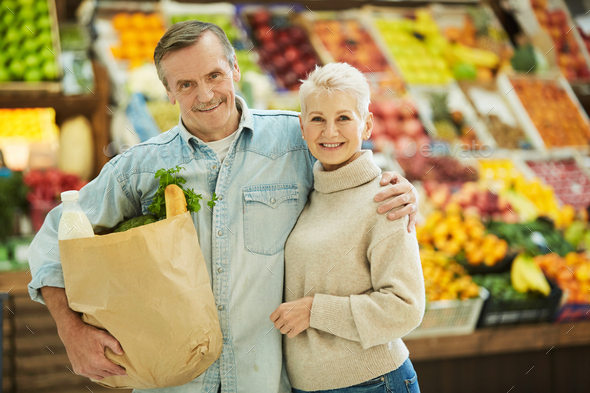 Modern Senior Couple Grocery Shopping in Supermarket - Stock Photo - Images