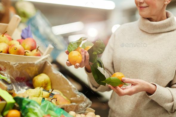 Woman Choosing Fruits at Farmers Market - Stock Photo - Images