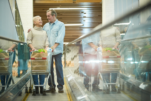 Senior Couple Shopping in Mall - Stock Photo - Images