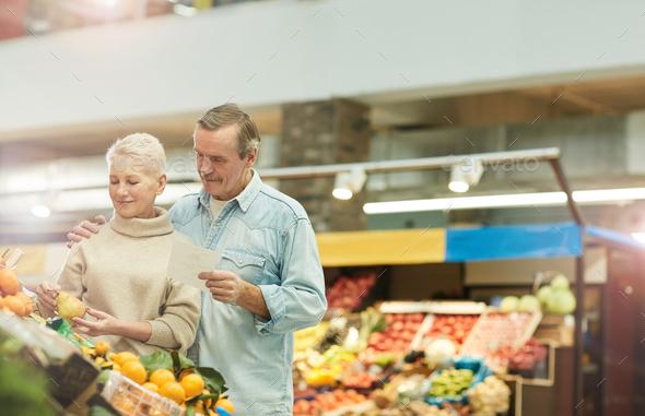 Senior Couple at Farmers Market - Stock Photo - Images