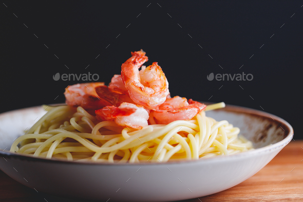 Fried shrimps on the pasta - Stock Photo - Images
