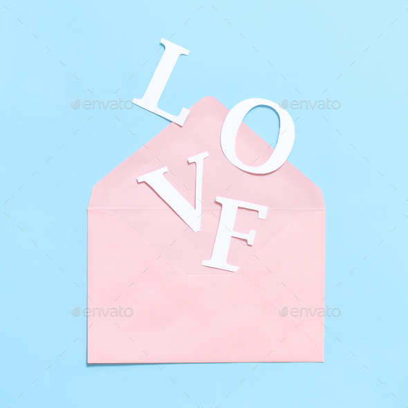 Word LOVE and pink envelope on a light blue background - Stock Photo - Images