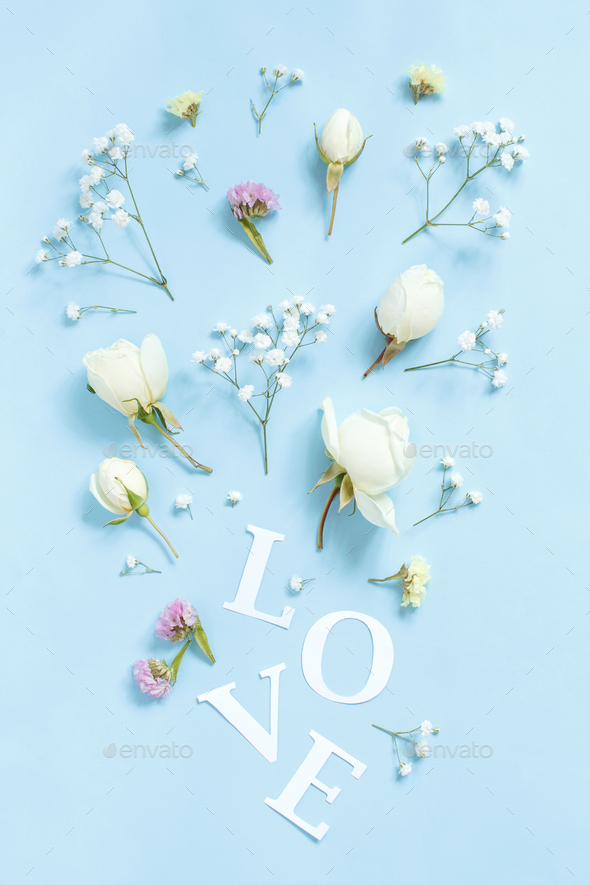 Flowers and word LOVE on a light blue background - Stock Photo - Images