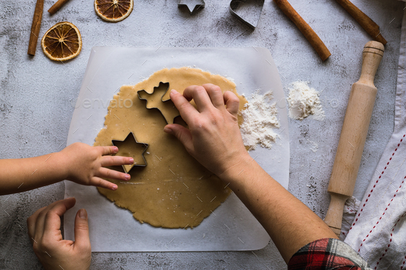 Cooking Christmas gingerbread cookies on a gray background - Stock Photo - Images