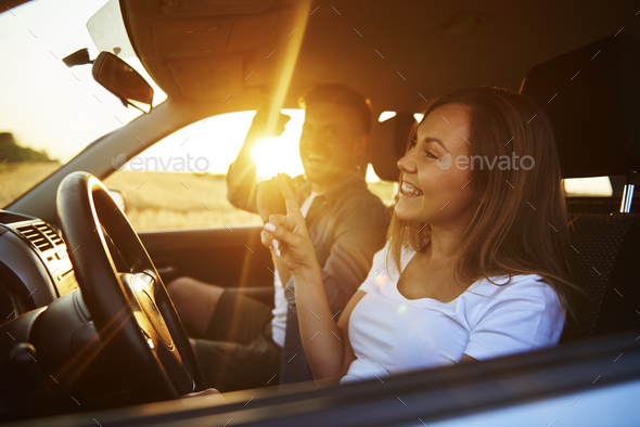 Cheerful couple having a fun during road trip - Stock Photo - Images