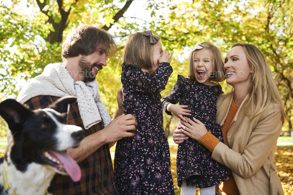 Joyful scene of family in autumn forest - Stock Photo - Images