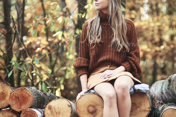 Fashionable young woman in autumn woods - Stock Photo - Images