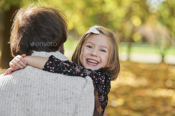 Portrait of happy girl embracing her daddy - Stock Photo - Images