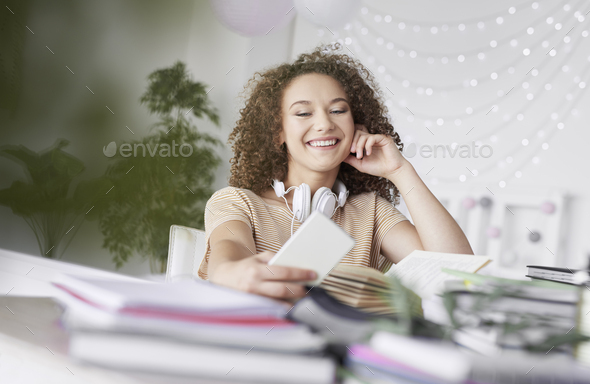 Happy teenage girl making a selfie - Stock Photo - Images
